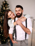 Happy couple on background of Christmas tree Royalty Free Stock Images