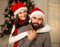 Happy couple on background of Christmas tree at home Stock Photography