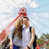 Happy couple on the background of the ferris wheel Stock Photography