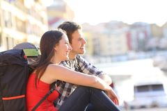 Couple of backpackers sightseeing on vacation. Happy couple of backpackers sightseeing on summer vacation Royalty Free Stock Image