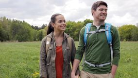 Happy couple with backpacks hiking outdoors 1