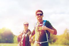 Happy couple with backpacks hiking outdoors Royalty Free Stock Photos