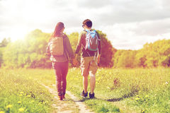 Happy couple with backpacks hiking outdoors Stock Images