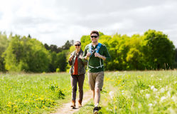 Happy couple with backpacks hiking outdoors Royalty Free Stock Images