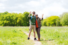 Happy couple with backpacks hiking outdoors Royalty Free Stock Photo
