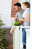 Happy couple at balcony Stock Photos