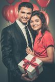Happy couple with balloons Stock Image