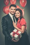 Happy couple with balloons royalty free stock photo