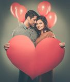 Happy couple with balloons Stock Images