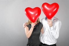 Happy couple with balloons instead of a head Stock Image