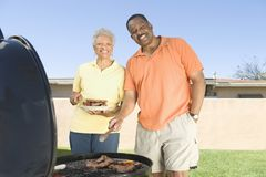 Happy Couple Barbecuing Royalty Free Stock Images