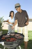 Happy Couple Barbequing Royalty Free Stock Photos