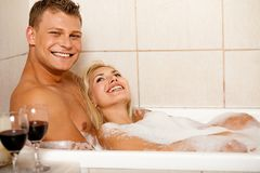 Happy couple in bath Stock Photos