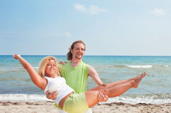Happy couple on the beach Royalty Free Stock Photography