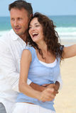Happy couple at the beach Royalty Free Stock Photo