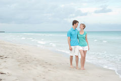 Happy couple on the beach Stock Photos