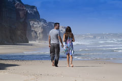 Happy couple in the beach. Happy couple walking in the beah Royalty Free Stock Photo