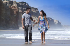 Happy couple in the beach. Happy couple walking on the beach Royalty Free Stock Images