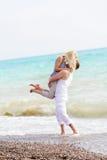 Happy couple on beach Royalty Free Stock Photo
