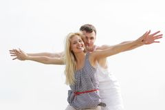 Happy couple on beach Royalty Free Stock Images
