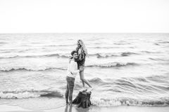 Happy couple at the beach Stock Images
