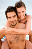 Happy couple at the beach Stock Photography