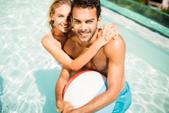 Happy couple with beach ball Royalty Free Stock Images