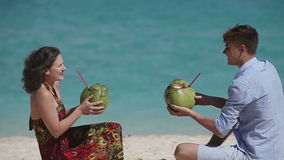 Happy couple on the beach with coconut stock video