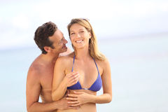 Happy couple on the beach embracing Royalty Free Stock Image