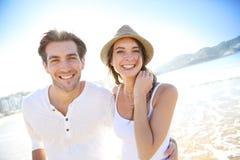 Happy couple on the beach enjoying summer time Stock Photo