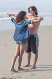 Happy couple at beach Stock Photography