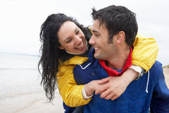 Happy couple on beach in love Stock Photo