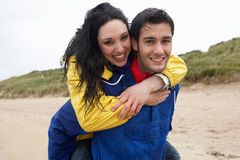 Happy couple on beach in love Royalty Free Stock Photos