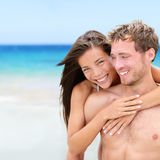 Happy couple on beach Stock Image