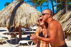 Happy couple on the beach Stock Photography