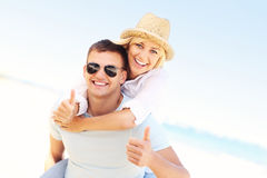 Happy couple at the beach Royalty Free Stock Images