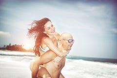 Happy couple on a beach Stock Image