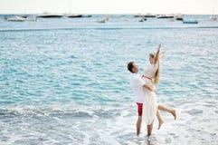 Happy couple on the beach of Positano, Amalfi coast, Italy Royalty Free Stock Images