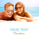 Happy Couple on the Beach. Happy Couple in Sunglasses Having Fun on the Beach. Summer Royalty Free Stock Photos