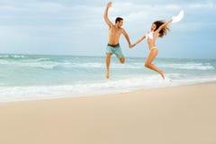 Happy couple on beach Stock Photography