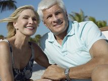 Happy Couple On Beach Vacation Stock Images