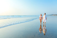 Happy couple on a beach stock images