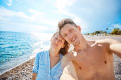 Happy couple on the beach Stock Images