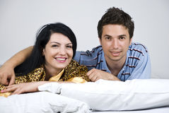 Happy couple in bed Royalty Free Stock Photography