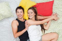 Happy couple in bed Stock Images
