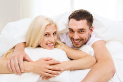 Happy couple in bed at home Royalty Free Stock Image