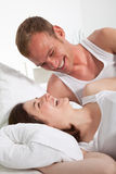 Happy Couple in Bed Next to One Another Royalty Free Stock Photo