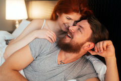 Happy couple in bed showing emotions. And love Stock Photography