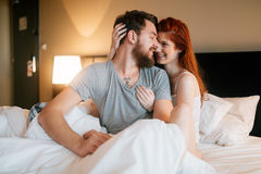Happy couple in bed showing emotions. And love Royalty Free Stock Images