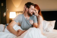 Happy couple in bed showing emotions. And love Stock Images